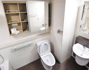 elongated toilet in restroom